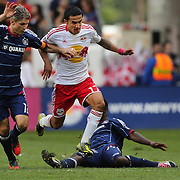 Tim Cahill, New York Red Bulls, is challenged by Logan Pause, Chicago Fire, during the New York Red Bulls V Chicago Fire Major League Soccer regular season match at Red Bull Arena, Harrison. New Jersey. USA. 6th October 2012. Photo Tim Clayton