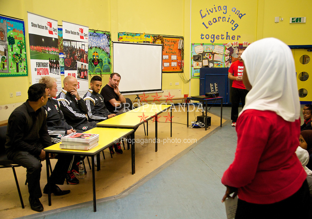 NEWPORT, WALES - Tuesday, October 7, 2014: Wales' Jonathan Williams, David Cotterill and Neil Taylor visit Mount Stuart School for a Show Racism the Red Card promotion ahead of the UEFA Euro 2016 qualifying match against Bosnia and Herzegovina. (Pic by David Rawcliffe/Propaganda)
