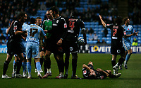 Photo: Steve Bond/Sportsbeat Images.<br />Coventry City v West Bromwich Albion. Coca Cola Championship. 12/11/2007. Michael Mifsud (17) about to get sent off. Carl Hoefkens lies injured