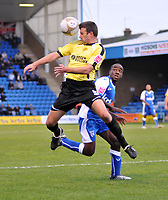 Photo: Tony Oudot/Richard Lane Photography. Gillingham v Burton Albion. FA Cup 2nd Round. 28/11/2009. <br /> Tony James of Burton clears watched by Febian Brandy of Gillingham