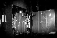 ..Alejandra, a single mom, performs as an exotic dancer in a local discotec. She has worked as a dancer for over five years and is considered to have one of the best routines, usually saved for the end of the night. ....Despite her confidence in her ability to dance, Alejandra is self conscious about her weight and is constantly crash dieting. She recently spent an entire night's wages on a constricting undershirt advertised to slim one's waistline when worn regularly. At 30-years-old and after giving birth to her daughters, she says it is a lot harder to keep weight off than it was when she was younger.