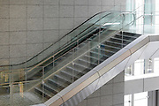 empty public space with stairs and escalator in large office building