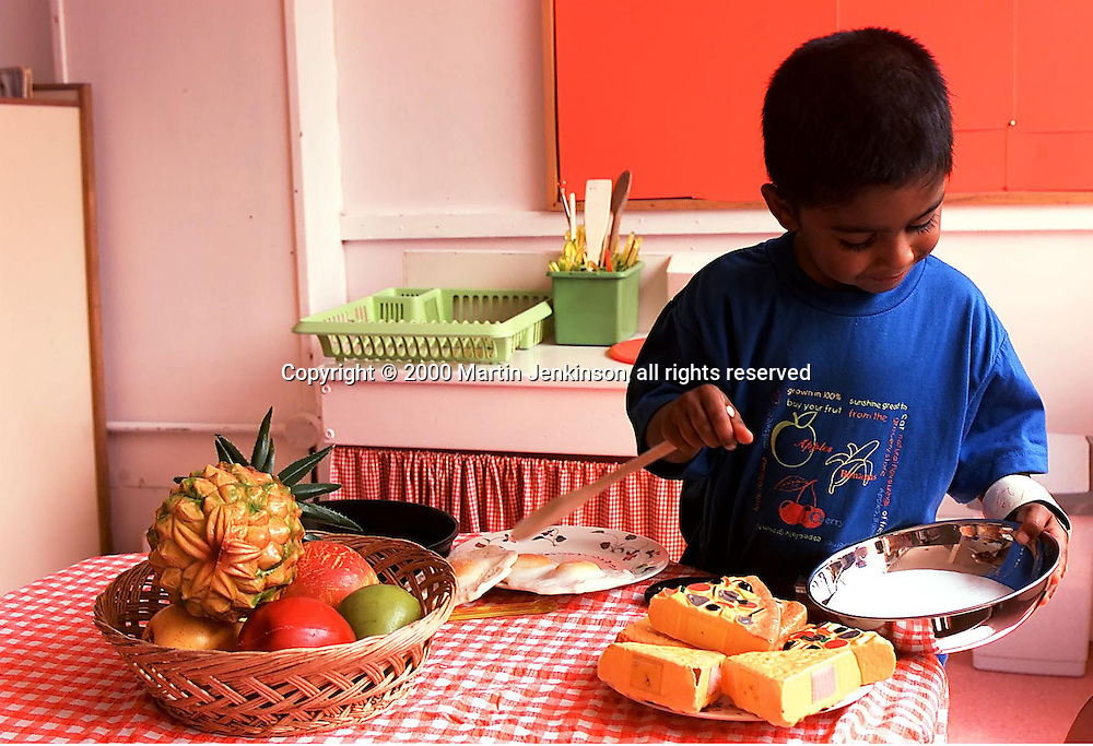Young child 'cooking' at Grace Owen Nursery School, Sheffield....©Martin Jenkinson, tel 0114 258 6808 mobile 07831 189363 email martin@pressphotos.co.uk. Copyright Designs & Patents Act 1988, moral rights asserted credit required.