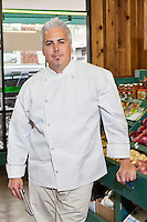 Portrait of a mid adult chef standing in market