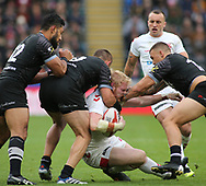 James Graham (C) of England  tackled by Jared Waerea-Hargreaves and Kevin Proctor (R) of New Zealand during the Autumn International Series match at the KCOM Stadium, Hull<br /> Picture by Stephen Gaunt/Focus Images Ltd +447904 833202<br /> 27/10/2018