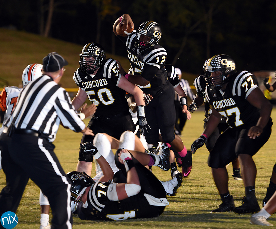 Concord's Jadon Bell (12) against Northwest Cabarrus Friday night at Concord High School. Concord won 41-20.