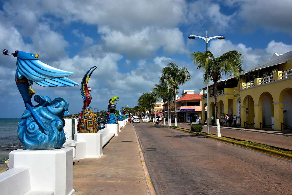 Avenue Rafael E. Melgar in San Miguel, Cozumel, Mexico<br /> San Miguel&rsquo;s main tourist district runs along the waterfront on Avenue Rafael E. Melgar.  Here you will find the major shops, restaurants and attractions such as the Museo de la Isla de Cozumel on the right. This is a natural and human history museum with fascinating displays from the pre-Columbian and colonial periods. The street&rsquo;s namesake is Brigadier General Rafael Eustace Melgar. After his critical military service during the Mexican Revolution, he became a powerful politician. Towards the end of his career, he was the Mexican ambassador to the Netherlands and then a national senator from 1952 until 1958.