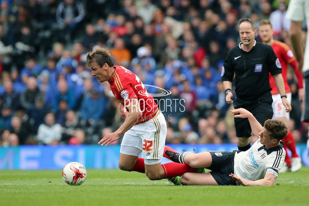 Fulham midfielder and captain, Scott Parker (08) fouling Nottingham Forest midfielder Robert Tesche (32) during the Sky Bet Championship match between Fulham and Nottingham Forest at Craven Cottage, London, England on 23 April 2016. Photo by Matthew Redman.