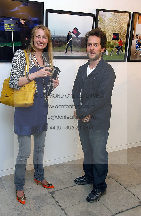 CLEMENTINE HAMBRO and actor TOM HOLLANDER at an exhibition of photographs entitled 'Protect The Human' by photographers Jake Gavin and Sean Gleason commissioned by Amnesty Internationlal and held at The Hospital, 24 Endell Street, London WC2 on 31st May 2006.<br /><br />NON EXCLUSIVE - WORLD RIGHTS