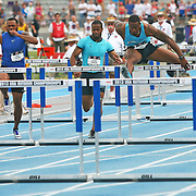 OLIVER.WILSON - 13USA, Des Moines, Ia. - David Oliver is even with Ryan Wilson in the finals of the 110 hurdles.  Wilson edged Oliver 13.08 to 13.11.   Photo by David Peterson