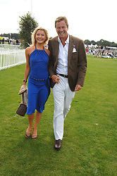 ROBERT HERSOV and DR KATIE JAMES at the Cartier International polo at Guards Polo Club, Windsor Great Park on 29th July 2007.<br />