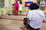 "30 JANUARY 2013 - PHNOM PENH, CAMBODIA: Cambodians pray at a memorial for former King Norodom Sihanouk at the Royal Palace in Phnom Penh. Sihanouk (31 October 1922 - 15 October 2012) was the King of Cambodia from 1941 to 1955 and again from 1993 to 2004. He was the effective ruler of Cambodia from 1953 to 1970. After his second abdication in 2004, he was given the honorific of ""The King-Father of Cambodia."" Sihanouk held so many positions since 1941 that the Guinness Book of World Records identifies him as the politician who has served the world's greatest variety of political offices. These included two terms as king, two as sovereign prince, one as president, two as prime minister, as well as numerous positions as leader of various governments-in-exile. He served as puppet head of state for the Khmer Rouge government in 1975-1976. Most of these positions were only honorific, including the last position as constitutional king of Cambodia. Sihanouk's actual period of effective rule over Cambodia was from 9 November 1953, when Cambodia gained its independence from France, until 18 March 1970, when General Lon Nol and the National Assembly deposed him. Upon his final abdication, the Cambodian throne council appointed Norodom Sihamoni, one of Sihanouk's sons, as the new king. Sihanouk died in Beijing, China, where he was receiving medical care, on Oct. 15, 2012. His cremation is scheduled to take place on Feb. 4, 2013. Over a million people are expected to attend the service.        PHOTO BY JACK KURTZ"