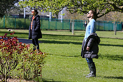 © Licensed to London News Pictures. 04/04/2020. London, UK. Members of the public enjoy the sunshine in Finsbury park, north London and keeping 2 meters apart, during coronavirus lockdown. According to the Met Office, temperature in London is likely to reach 20 degrees this weekend. The Government has ordered that people go out only for food and health reasons or for work, and keep 2 meters away from other people at all times to slow the spread of the virus and reduce pressure on the NHS. Photo credit: Dinendra Haria/LNP