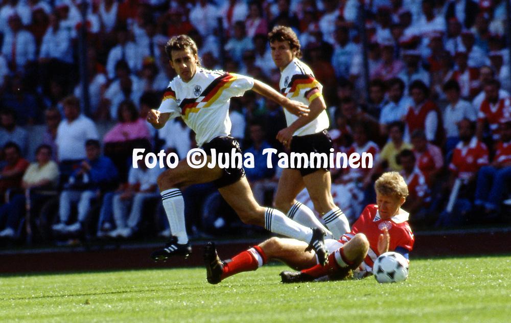 UEFA European Championship - West Germany 1988<br /> 14.6.1988, Parkstadion, Gelsenkirchen.<br /> Group 1, West Germany v Denmark.<br /> Pierre Littbarski (West Germany) v Morten Olsen (Denmark).