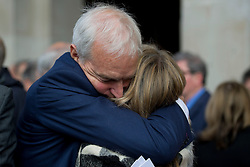 © Licensed to London News Pictures. 16/05/2012. London, UK. BBC presenter and journalist Jon Snow embracing an unknown woman as he leaves St Martin in the Fields church, London following a memorial service held for American Sunday Times journalist Marie Colvin, who died covering the siege of Homs in Syria.  Photo credit : Ben Cawthra/LNP