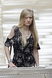 © Licensed to London News Pictures. 26/07/2017. London, UK. CONNIE YATES and CHRIS CARD arrive at The The Royal Courts of Justice in London . The parents of terminally ill Charlie Gard have returned to court in an attempt to take their terminally ill son home to die rather than ending his life in hospital. The court ruled that Charlie, who suffers from a rare genetic condition known as mitochondrial DNA depletion syndrome, should not be taken to US for further treatment. Photo credit: Peter Macdiarmid/LNP
