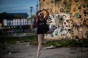 Isabel Sandi of the Manguinhos community ballet, poses for a picture in the degraded surroundings of the Biblioteca Parque public library in Manguinhos neighbourhood in Rio de Janeiro, Brazil, Monday, June 11, 2018.  The Manguinhos community ballet has been a reprieve from the violence and poverty that afflicts its namesake neighborhood for hundreds of girls who have benefitted from free dance classes since 2012. (Dado Galdieri for The New York Times)