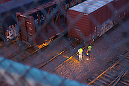 Two Union Pacific Railroad employees look over a cut of freight cars in the giant Proviso Yard in suburban Chicago.