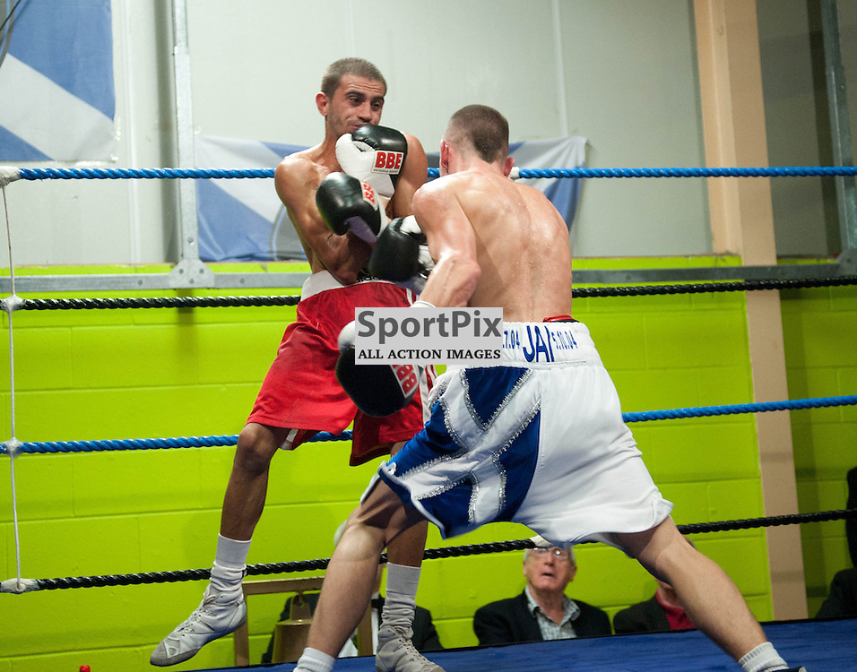 Iain Butcher has his opponent Stefan Slavchev on the ropes. Prospect Boxing Flyweight Bout, Iain Butcher v Stefan Slavchev, Rivals Gym, Wishaw, 06 October 2012 Angela Isac | StockPix.eu