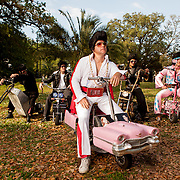 The Krewe of the Rolling Elvi in Colliseum Square Park in New Orleans. A crowd favorite during Mardi Gras, the Rolling Elvi  were founded in 2003 to honor the King of Rock and Roll while entertaining New Orleans Parade goers. The Rolling Elvi ride custom-designed Elvis themed scooters in between floats at parades.