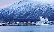 For around two months for the year, the area around Tromsø in northern Norway doesn't see the sun. Photographed a week after the sun rose for the final time before winter, and the morning after the first snow of the season, showing the typical blue light over the Arctic Cathedral or Tromsdalen Church.