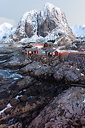 Eliasson Rorbuer Holiday Cabins are situated  on the edge of the Norwegian Sea. They are traditional red wooden buildings within the compound are surrounded by imposing cliff faces and offer a stunning way experience the wonders of Lofoten.