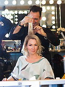 Jennie Garth with Gerard Caruso of RUSK  backstage at Nolcha Fashion Week New York Fall-Winter 2014. Nolcha Fashion Week New York is a leading award winning event, held during New York Fashion Week, for independent fashion designers to showcase their collections to a global audience of press, retailers, stylists and industry influencers. Over the past six years Nolcha Fashion Week: New York has established itself as a platform of discovery promoting innovative fashion designers through runway shows and exhibition. Nolcha Fashion Week: New York has built an acclaimed reputation as a hot incubator of new fashion design talent and is officially listed by New York City Economic Development Corporation; offering a range of cost effective options to increase designers recognition and develop their business. (Photo: www.JeffreyHolmes.com)