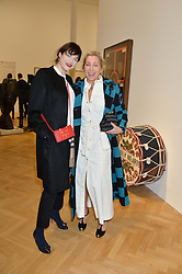 Left to right, JASMINE GUINNESS and MAIA NORMAN at the opening private view of 'A Strong Sweet Smell of Incense - A portrait of Robert Fraser, held at the Pace Gallery, Burlington Gardens, London on 5th February 2015.