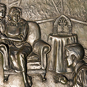 "1938 Martian Landing Site Monument. Detail of freightened family listening to the radio.......Monument commemorates Orson Welles' famous broadcast of a radio adaptation of H.G.Wells' ""War of the Worlds"" in which a Martian invasion force landed at Grovers Mill, New Jersey. The broadcast was initially believed to be true by many."