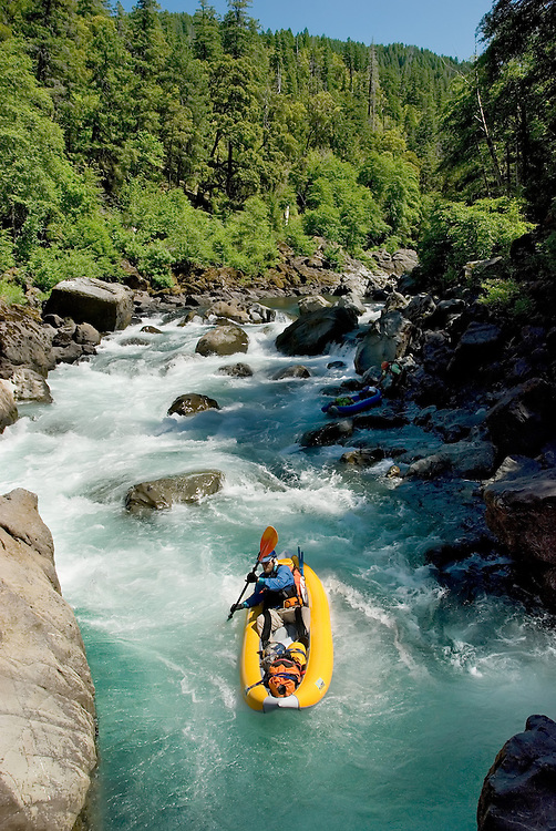 Paddling an inflatable kayak down Submarine Hole Rapid on the Illinois River in Oregon's Siskiyou Mountains.