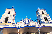 The Basilica of Our Lady of Mount Carmel Catholic Church in Catemaco, Veracruz, Mexico. The town is built along a tropical freshwater lake at the center of the Sierra de Los Tuxtlas mountains, is a popular tourist destination and known for free ranging monkeys, the rainforest backdrop and Mexican witches known as Brujos.