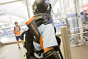 CHINA, Hong Kong: 13 August 2019 <br /> A member of the riot police carries with him a gun labelled 'Less Lethal' during clashes with protesters at Hong Kong International Airport on the evening of 13th August 2019. Thousands of demonstrators brought Hong Kong's airport to a standstill for a second day in a row in protest of the extradition bill as well as the police violence and brutality. Demonstrators have taken to the streets of Hong Kong in protest of a controversial extradition bill since 9th of June which has resulted in several violent clashes.<br /> Rick Findler / Story Picture Agency