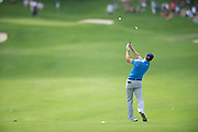 Jordan Spieth hits an iron from the fairway during the first round of the AT&T Byron Nelson in Las Colinas, Texas on May 28, 2015. (Cooper Neill for The New York Times)