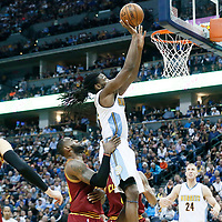 22 March 2017: Denver Nuggets forward Kenneth Faried (35) goes for the jump shot past Cleveland Cavaliers forward LeBron James (23) during the Denver Nuggets 126-113 victory over the Cleveland Cavaliers, at the Pepsi Center, Denver, Colorado, USA.