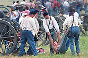 An injured Union solder is taken from the battle field during during the reenactment of the Battle of Bull Run  at Brawner Farm in Manassas, Virginia on July 24, 2011.  This event marked the 150th anniversary of the the first major battle of the Civil War.  UPI/Kevin Dietsch