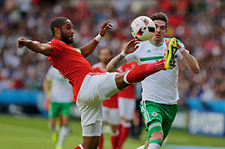 PARIS, FRANCE - Saturday, June 25, 2016: Wales' captain Ashley Williams in action against Northern Ireland's Kyle Lafferty during the Round of 16 UEFA Euro 2016 Championship match at the Parc des Princes. (Pic by David Rawcliffe/Propaganda)