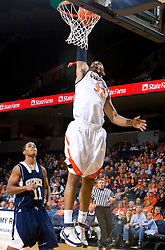 Virginia forward Mike Scott (32) skies for a dunk against Shepherd.  The Virginia Cavaliers defeated the Shepherd Rams 87-52 in an NCAA basketball exhibition game at the University of Virginia's John Paul Jones Arena in Charlottesville, VA on November 9, 2008.