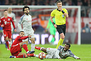 CORRECTION Bayern Munich defender Javi Martinez (8) battles for possession with Liverpool midfielder Georginio Wijnaldum (5)  during the Champions League match between Bayern Munich and Liverpool at the Allianz Arena, Munich, Germany, on 13 March 2019.