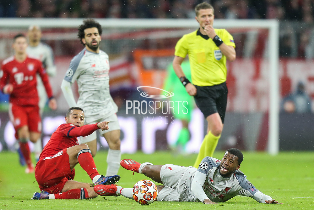 CORRECTION Bayern Munich defender Javi Martinez (8) battles for possession with Liverpool midfielder Georginio Wijnaldum (5)  during the Champions League match between Bayern Munich and Liverpool at the Allianz Arena, Munich, Germany, on 13 March 2019.