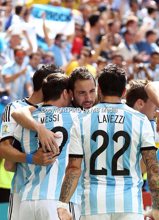 Fifa Soccer World Cup - Brazil 2014 - <br /> ARGENTINA (ARG) Vs. BELGIUM (BEL) - Quarter-finals - Estadio Nacional Brasilia -- Brazil (BRA) - 05 July 2014 <br /> Here Argentine player Angel Di Maria (L), Lionel Messi (C), Gonzalo Higuain (C) and Ezequiel Lavezzi (R)  celebrating Higuain's goal. Scoring the match 1-0.<br /> &copy; PikoPress