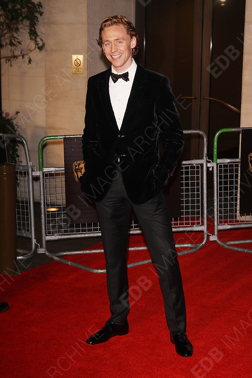 12.FEBRUARY.2012. LONDON<br /> <br /> TOM HIDDLESTON ATTENDS THE ORANGE BRITISH ACADEMY FILM AWARDS AFTER PARTY AT THE GROSVENOR HOUSE HOTEL IN LONDON<br /> <br /> BYLINE: EDBIMAGEARCHIVE.COM<br /> <br /> *THIS IMAGE IS STRICTLY FOR UK NEWSPAPERS AND MAGAZINES ONLY*<br /> *FOR WORLD WIDE SALES AND WEB USE PLEASE CONTACT EDBIMAGEARCHIVE - 0208 954 5968*