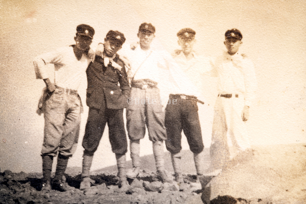 friends together on a hiking trip Japan ca 1940s