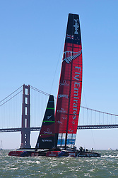 Emirates Team New Zealand skippered by Dean Barker sails past the Golden Gate Bridge in the San Francisco Bay during the 2013 America's Cup Finals San Francisco, California.