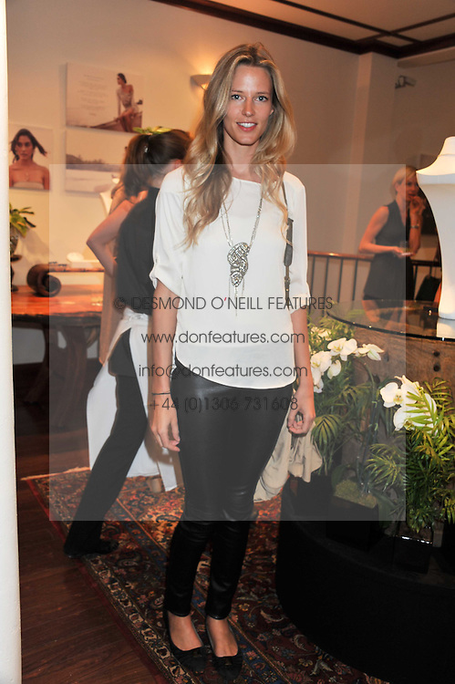 OLIVIA HUNT at a party to celebrate the launch of the new Mauritius Collection of jewellery by Forbes Mavros held at Patrick Mavros, 104-106 Fulham Road, London SW3 on 5th July 2011.
