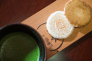 Matcha Tea, a special form of green tea served with Rice Cakes. Macha is the type of tea served at tea ceremony which centers on the preparation, serving, and drinking of matcha.