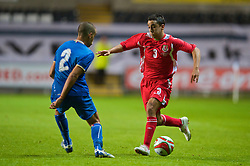 SWANSEA, ENGLAND - Friday, September 4, 2009: Wales' Neil Taylor and Italy's Giuseppe Bellusci during the UEFA Under 21 Championship Qualifying Group 3 match at the Liberty Stadium. (Photo by David Rawcliffe/Propaganda)