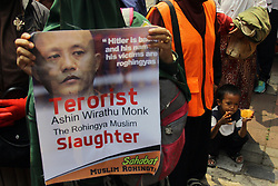 September 4, 2017 - Jakarta, Indonesia - Indonesian Muslim activists who are members of the Muslim Friends of Rohingya took action at the Embassy of Myanmar, Jakarta, Indonesia, Monday. Hundreds of Muslim activists staged a demonstration denouncing the Myanmar government for continued persecution of the Rohingya Muslim minority. (Credit Image: © Edi Ismail/NurPhoto via ZUMA Press)