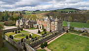 Aerial view of Abbotsford House, built 1817-25 by Sir Walter Scott, 1771-1832, Scottish writer and poet, near Melrose, in the Borders, Scotland. The building is in Scottish Baronial style and includes Scott's personal collections of books, furniture and Scottish historical artefacts, making it a centre for European Romanticism. The Scott family still own the building, which is open to the public as a tourist attraction. Picture by Manuel Cohen
