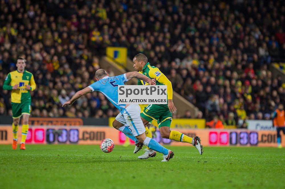 Norwich City midfielder Vadis Odjidja-Ofoe (32) tries to pass Manchester City defender Pablo Zabaleta (5)