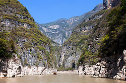 Excursion boat(s) on Goddess Stream, tributary of the Yangtze River, China.  This was once a wild river caving through a rugged canyon, tamed now by the construction of the Three Gorges Dam.